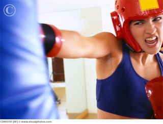 Woman_hitting_punching_bag_cb055797