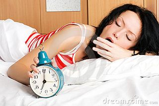 Young-woman-waking-up-and-yawning-in-the-morning-thumb7222033